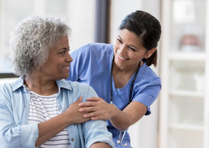 a nurse with an old patient