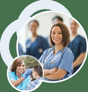 Two smiling women in nurse uniforms