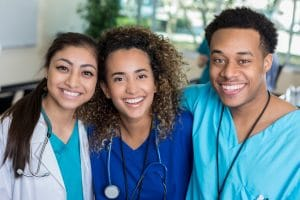 three young nurses smiling