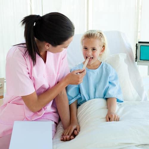young nurse attending a child patient